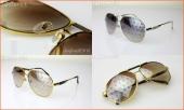 Солнцезащитные очки Louis Vuitton с монограммами (значками) на стеклах